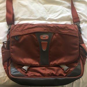 Orange Tumi Laptop Bag
